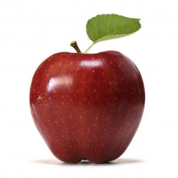 葉っぱがついているりんご。